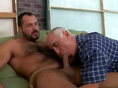 an old fellow is engulfing his boy-friends penis
