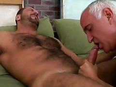 an old guy is engulfing his boy-friends schlong