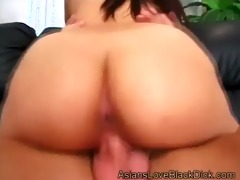 youthful oriental with sexy ass mounts massive