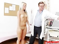 old doctor checks juvenile golden-haired gal