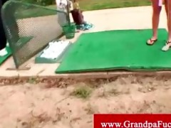 favourable old dude plays golf with sexy legal
