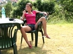 little caprice smoking in the garden