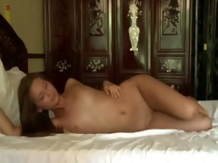 juvenile blackhair sweetheart teasing in bed