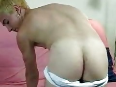 blond young chap masturbates on a bed