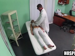 brunette hair patient getting massaged by her